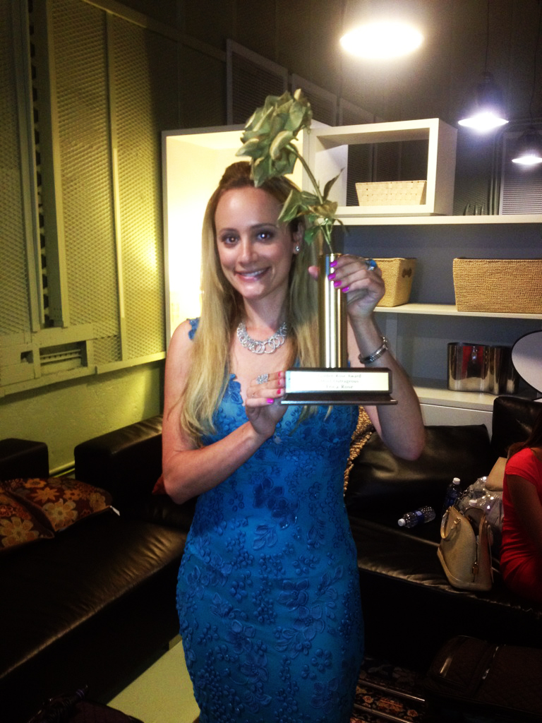 Erica Rose recieves the Golden Rose award - Katie Couric